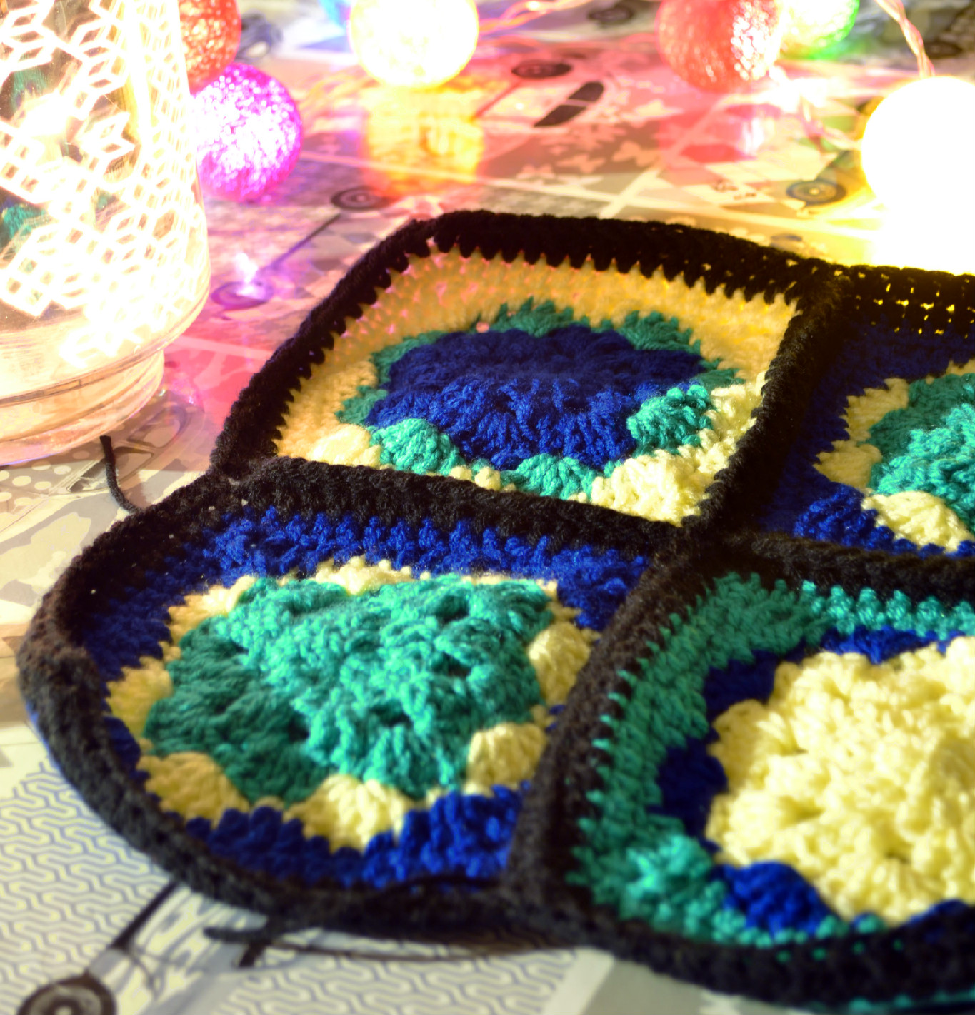 granny squares on table with lights